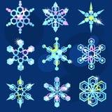 Un insieme di nove fiocchi di neve scintillanti Fotografie Stock Libere da Diritti