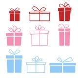 Un insieme di nove icone variopinte dei contenitori di regalo su fondo leggero Immagine Stock