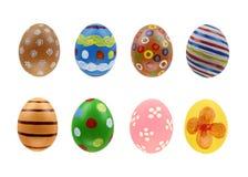 Un insieme di otto uova di Pasqua isolate su fondo bianco per il giorno felice di pasqua di progettazione Fotografia Stock Libera da Diritti