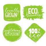 Un insieme di quattro etichette sane dell'alimento con iscrizione Immagini Stock