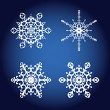 Un insieme di quattro fiocchi di neve eleganti, elementi decorativi di progettazione Fotografie Stock Libere da Diritti