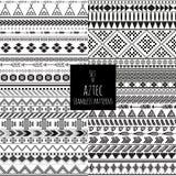 Un insieme di quattro modelli in bianco e nero senza cuciture aztechi di colore royalty illustrazione gratis
