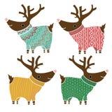 Un insieme di quattro renne sveglie nel divertirsi tricottato Immagini Stock Libere da Diritti