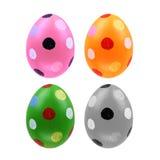 Un insieme di quattro uova di Pasqua isolate su fondo bianco per progettazione Immagini Stock