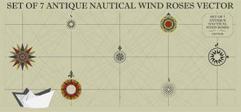 Un insieme di sette rose dei venti nautiche antiche illustrazione di stock