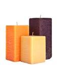 Un insieme di tre candele quadrate isolate su bianco Immagine Stock