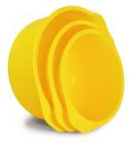 Un insieme di tre ciotole di plastica gialle Fotografia Stock Libera da Diritti