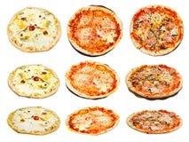 Un insieme di tre generi di pizza italiana Immagini Stock