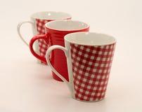 Un insieme di tre tazze Fotografia Stock