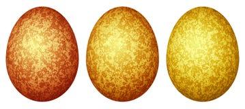 Un insieme di tre uova di Pasqua colorate (rosso, arancio, yel Fotografie Stock