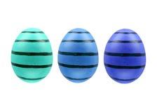 Un insieme di tre uova di Pasqua isolate su fondo bianco per progettazione Immagini Stock
