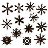Un insieme di tredici fiocchi di neve Siluetta nera Fotografia Stock