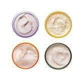 Un insieme di una crema differente di 4 cosmetici Immagine Stock Libera da Diritti