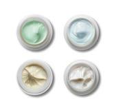 Un insieme di una crema differente di 4 cosmetici Fotografie Stock Libere da Diritti