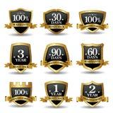 Un insieme di vettore delle etichette dorate di garanzia di 100 per cento Immagine Stock Libera da Diritti