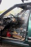 Un interior auto después del fuego Fotos de archivo
