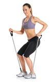 Un istruttore dei pilates con le fasce di esercitazione Immagine Stock