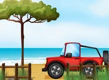 Un jeepney rouge à la plage illustration stock