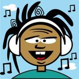 Un jeune garçon écoutant de la musique Photos stock