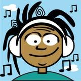 Un jeune garçon écoutant de la musique Image libre de droits