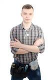 Un jeune homme au travail Image stock