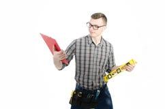 Un jeune homme au travail Image libre de droits