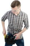 Un jeune homme au travail Images stock