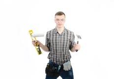 Un jeune homme au travail Photos stock