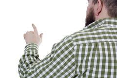 Un jeune homme barbu dirigeant son doigt Photo libre de droits