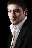 Un jeune homme d'affaires regardant fixement vous Photo libre de droits