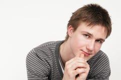 Un jeune homme songeur Photographie stock libre de droits