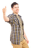Un jeune mâle heureux renonçant à un pouce Images stock