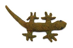 Un jouet bourré d'un lézard vert sale de gecko photo libre de droits