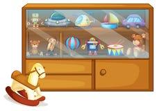 Un jouet de cheval près d'un coffret en bois Images stock