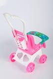 Un jouet de poussette de bébé photographie stock libre de droits