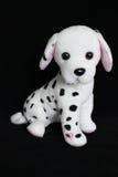 Un juguete dálmata del perro con los puntos negros para la decoración Imágenes de archivo libres de regalías