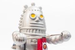 Un juguete del robot está montando la bicicleta Fotografía de archivo libre de regalías