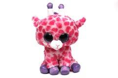 Un juguete suave de la jirafa linda con los puntos rosados fotografía de archivo