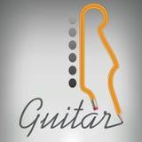 Un lápiz de la guitarra escribe su propio nombre Fotografía de archivo libre de regalías