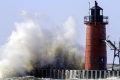 Un lago Michigan e un faro arrabbiati Fotografia Stock