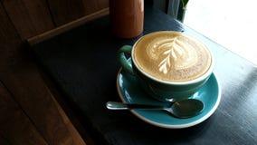 Un latte della tazza di caffè Immagini Stock