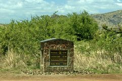 Un letrero indicativo de piedra en el parque nacional de Pilanesberg Fotografía de archivo libre de regalías