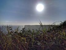 Un lever de soleil costal Photographie stock