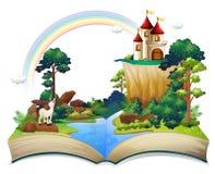 Un libro con un castillo en el bosque Foto de archivo