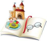 Un libro con un castillo y los vidrios de una lectura Fotos de archivo libres de regalías