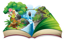 Un libro con una imagen de la naturaleza con una hada Imagenes de archivo