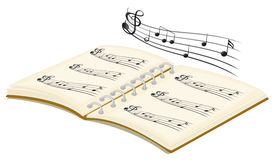 Un libro musical con las notas musicales Foto de archivo libre de regalías