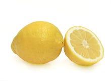 Un limone e una metà Fotografia Stock
