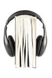 Un livre avec des écouteurs Images libres de droits