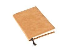 Un livre brun de velours avec le signet d'isolement Photo stock